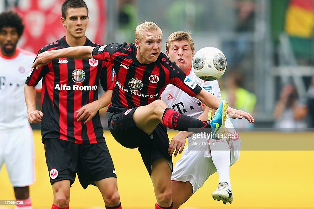 <a gi-track='captionPersonalityLinkClicked' href=/galleries/search?phrase=Sebastian+Rode&family=editorial&specificpeople=5704950 ng-click='$event.stopPropagation()'>Sebastian Rode</a> (L) of Frankfurt is challenged by <a gi-track='captionPersonalityLinkClicked' href=/galleries/search?phrase=Toni+Kroos&family=editorial&specificpeople=638597 ng-click='$event.stopPropagation()'>Toni Kroos</a> of Muenchen during the Bundesliga match between Eintracht Frankfurt and FC Bayern Muenchen at Commerzbank Arena on August 17, 2013 in Frankfurt am Main, Germany.