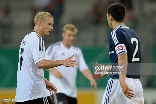 Sebastian Rode of Germany and Lisandro Magallan of Argentina shake hands after the Under 21 international friendly match between Germany U21 and...