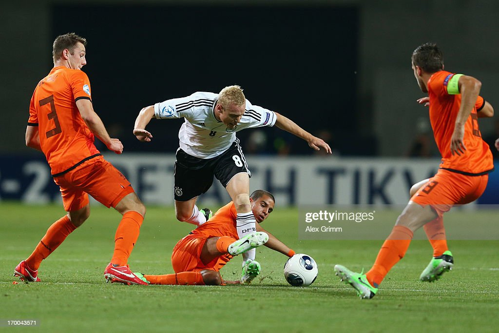 Sebastian Rode (C) of Germany is challenged by Stefan de Vrij, Adam Maher and Kevin Strootman (L-R) of Netherlands during the UEFA European Under 21 Championship match between Netherlands and Germany at Ha Moshava Stadium on June 6, 2013 in Petah Tiqwa, Israel.