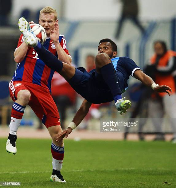 Sebastian Rode of Muenchen is challenged by Sultan Abdullah Alduayyi of AlHilal during the friendly match between Al Hilal and Bayern Muenchen on...