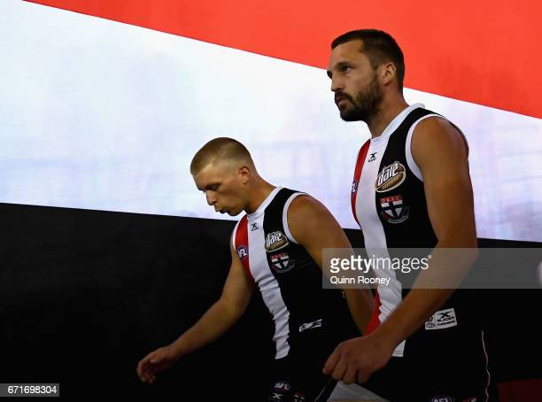 Sebastian Ross and Jarryn Geary of the Saints lead their team out onto the field during the round five AFL match between the St Kilda Saints and the...