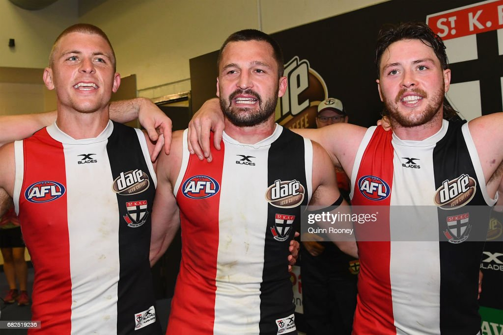 Sebastian Ross, Jarryn Geary and Jack Steven of the Saints sing the song in the rooms after winning the round eight AFL match between the St Kilda Saints and the Carlton Blues at Etihad Stadium on May 13, 2017 in Melbourne, Australia.