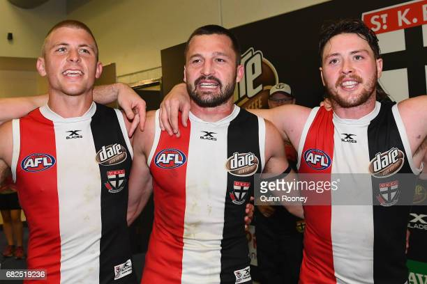Sebastian Ross Jarryn Geary and Jack Steven of the Saints sing the song in the rooms after winning the round eight AFL match between the St Kilda...