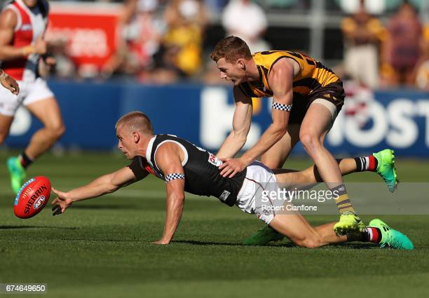 Sebastian Ross of the Saints is challenged by Tim O'Brien of the Hawks during the round six AFL match between the Hawthorn Hawks and the St Kilda...