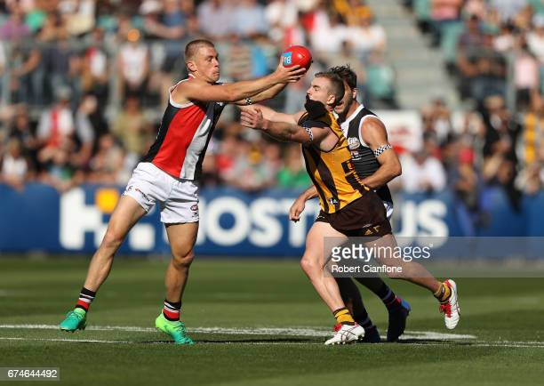 Sebastian Ross of the Saints is challenged by Tom Mitchell of the Hawks during the round six AFL match between the Hawthorn Hawks and the St Kilda...