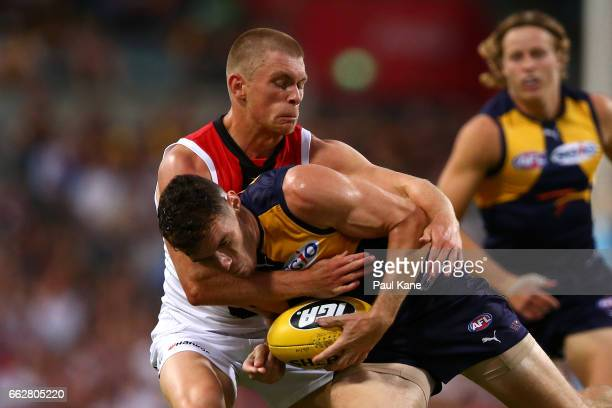 Sebastian Ross of the Saints tackles Luke Shuey of the Eagles during the round two AFL match between the West Coast Eagles and the St Kilda Saints at...