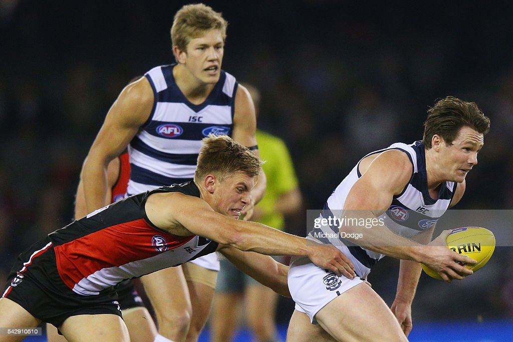 Sebastian Ross of the Saints tackles Patrick Dangerfield of the Cats during the round 14 AFL match between the St Kilda Saints and the Geelong Cats at Etihad Stadium on June 25, 2016 in Melbourne, Australia.