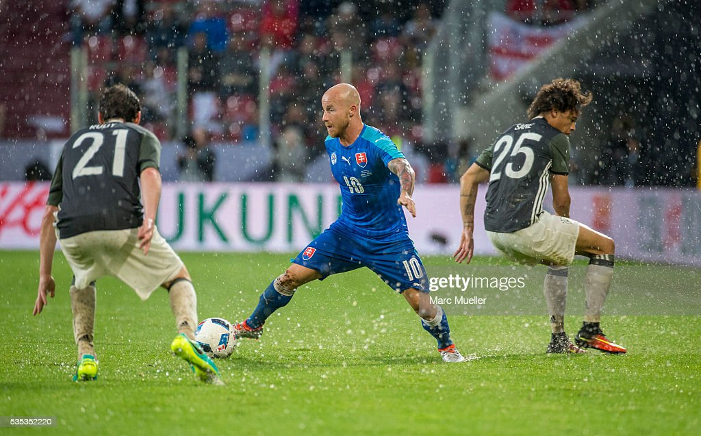 <a gi-track='captionPersonalityLinkClicked' href=/galleries/search?phrase=Sebastian+Rudy&family=editorial&specificpeople=4410074 ng-click='$event.stopPropagation()'>Sebastian Rudy</a> (L) and Leroy Sane (R) of Germany are challenged by <a gi-track='captionPersonalityLinkClicked' href=/galleries/search?phrase=Miroslav+Stoch&family=editorial&specificpeople=5446681 ng-click='$event.stopPropagation()'>Miroslav Stoch</a> of Slovakia during during the international friendly match between Germany and Slovakia at WWK-Arena on May 29, 2016 in Augsburg, Germany.