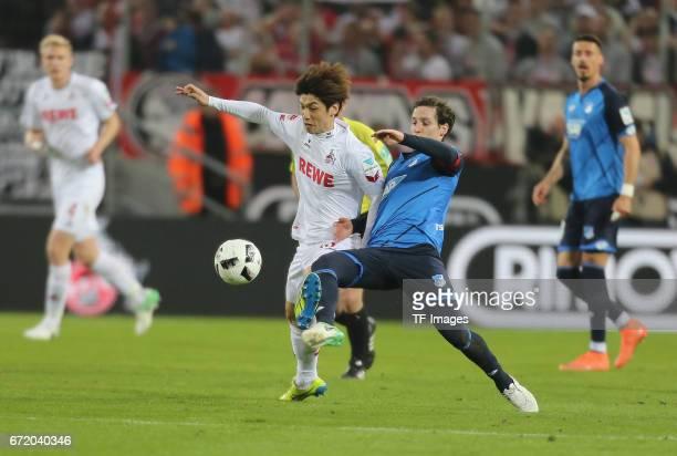 Sebastian Rudy and Yuya Osako battle for the ball during the Bundesliga match between 1 FC Koeln and TSG 1899 Hoffenheim at RheinEnergieStadion on...