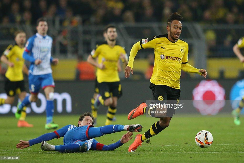 Sebastian Rudy of 1899 Hoffenheim fouls PierreEmerick Aubameyang of Borussia Dortmund leading to his red card during the Bundesliga match between...