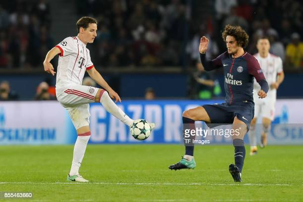 Sebastian Rudy of Bayern Muenchen and Adrien Rabiot of Paris SaintGermain battle for the ball during the UEFA Champions League group B match between...