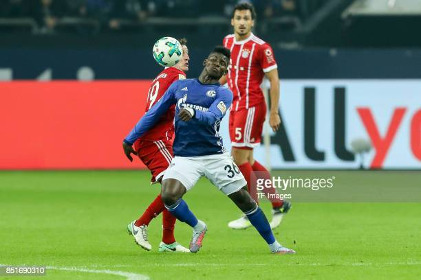 Sebastian Rudy of Bayern Muenchen and Breel Embolo of Schalke battle for the ball during the Bundesliga match between FC Schalke 04 and FC Bayern...