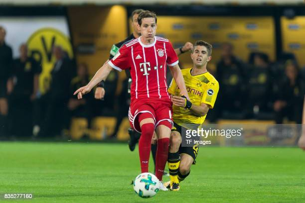 Sebastian Rudy of Bayern Muenchen and Christian Pulisic of Dortmund battle for the ball during the DFL Supercup 2017 match between Borussia Dortmund...