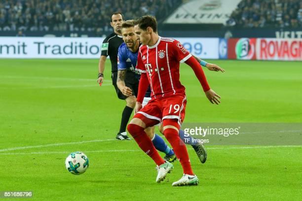 Sebastian Rudy of Bayern Muenchen and Guido Burgstaller of Schalke battle for the ball during the Bundesliga match between FC Schalke 04 and FC...