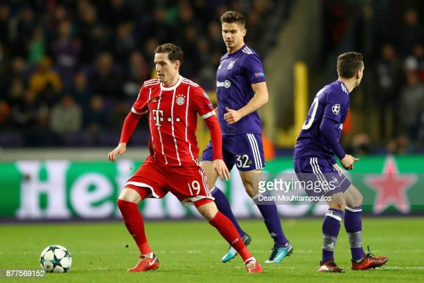 Sebastian Rudy of Bayern Muenchen and Leander Dendoncker of RSC Anderlecht battle for possession during the UEFA Champions League group B match...