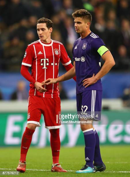 Sebastian Rudy of Bayern Muenchen and Leander Dendoncker of RSC Anderlecht shake hands during the UEFA Champions League group B match between RSC...