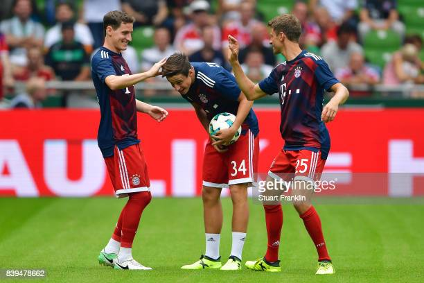 Sebastian Rudy of Bayern Muenchen Marco Friedl of Bayern Muenchen and Thomas Mueller of Bayern Muenchen during warm up ahead of the Bundesliga match...