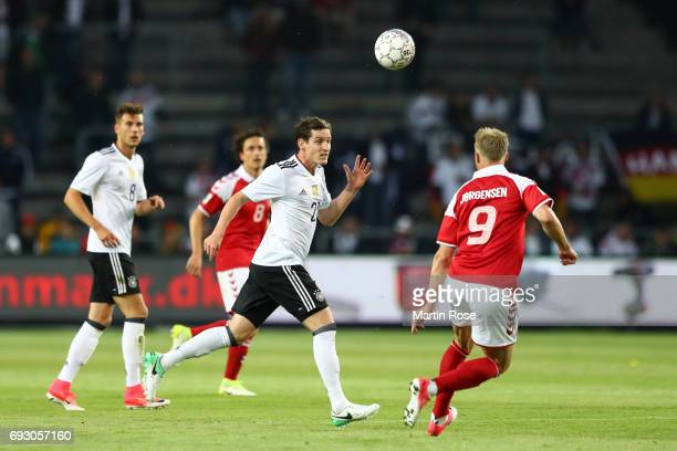 Sebastian Rudy of Germany and Nicolai Jorgensen of Denmark battle for the ball during the international friendly match between Denmark v Germany on...