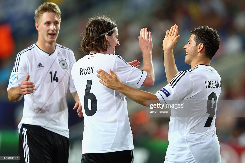 <a gi-track='captionPersonalityLinkClicked' href=/galleries/search?phrase=Sebastian+Rudy&family=editorial&specificpeople=4410074 ng-click='$event.stopPropagation()'>Sebastian Rudy</a> (C) of Germany celebrates his team's second goal with team mates Sebastian Polter (L) and <a gi-track='captionPersonalityLinkClicked' href=/galleries/search?phrase=Kevin+Volland&family=editorial&specificpeople=6001755 ng-click='$event.stopPropagation()'>Kevin Volland</a> during the UEFA European U21 Championship Group B match between Russia and Germany at Netanya Stadium on June 12, 2013 in Netanya, Israel.