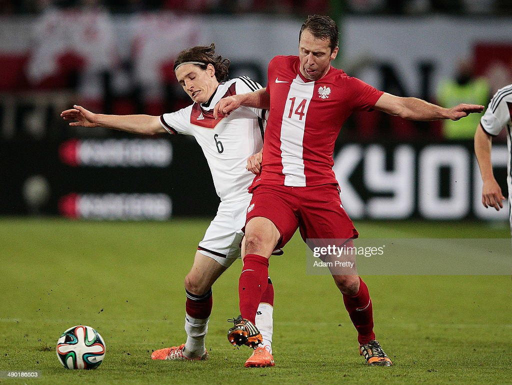 <a gi-track='captionPersonalityLinkClicked' href=/galleries/search?phrase=Sebastian+Rudy&family=editorial&specificpeople=4410074 ng-click='$event.stopPropagation()'>Sebastian Rudy</a> of Germany challenges <a gi-track='captionPersonalityLinkClicked' href=/galleries/search?phrase=Jakub+Wawrzyniak&family=editorial&specificpeople=4666843 ng-click='$event.stopPropagation()'>Jakub Wawrzyniak</a> of Poland during the International Friendly match between Germany and Poland at Imtech Arena on May 13, 2014 in Hamburg, Germany.