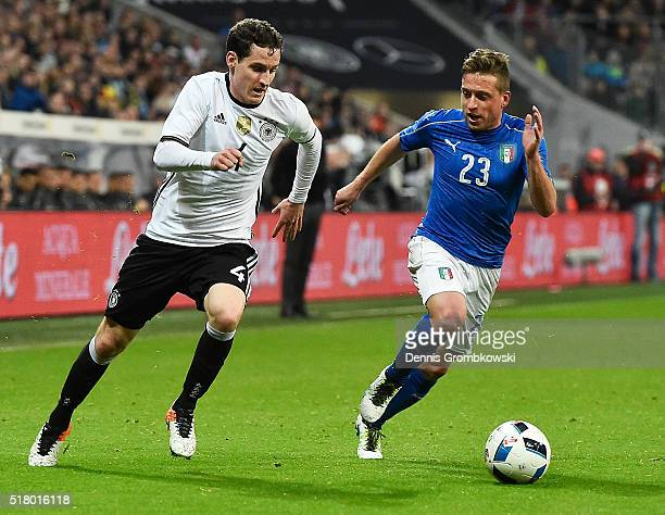 Sebastian Rudy of Germany gets past Emanuele Giaccherini of Italy during the International Friendly match between Germany and Italy at Allianz Arena...