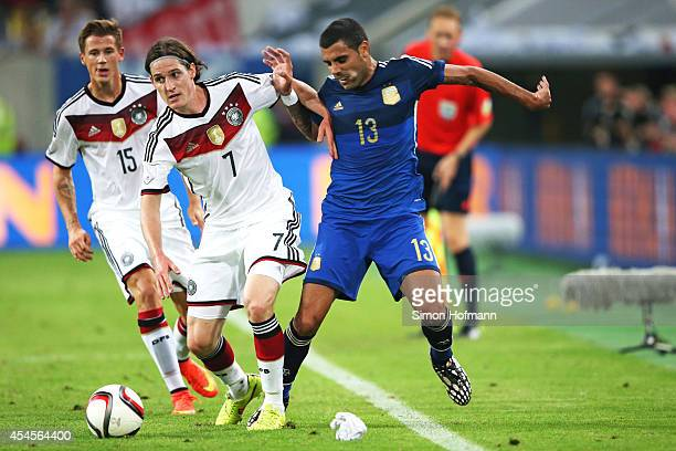 Sebastian Rudy of Germany is challenged by Augusto Fernandez of Argentina during the international friendly match between Germany and Argentina at...