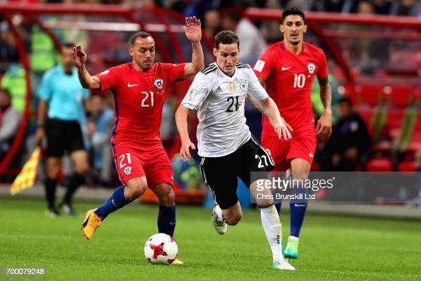 Sebastian Rudy of Germany runs past Marcelo Diaz of Chile during the FIFA Confederations Cup Russia 2017 Group B match between Germany and Chile at...