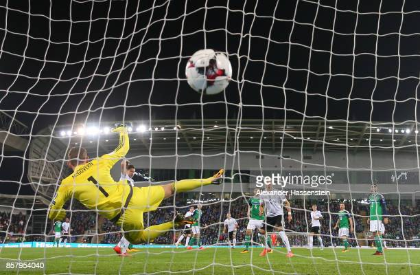 Sebastian Rudy of Germany shoots past Michael McGovern of Northern Ireland to score his goal during the FIFA 2018 World Cup Qualifier between...