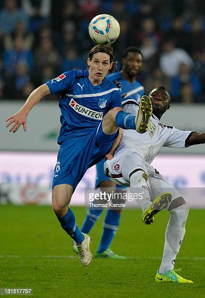 Sebastian Rudy of Hoffenheim and Dorge Kouemaha of Kaiserslautern vie for the ball during the Bundesliga match between 1899 Hoffenheim and 1 FC...