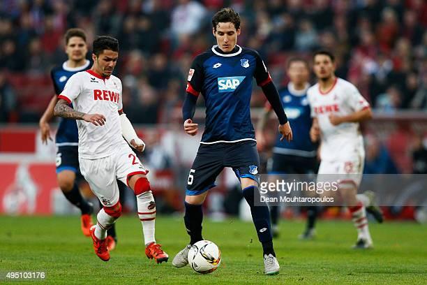 Sebastian Rudy of Hoffenheim and Leonardo Bittencourt of koeln in action during the Bundesliga match between 1 FC Koeln and TSG 1899 Hoffenheim held...