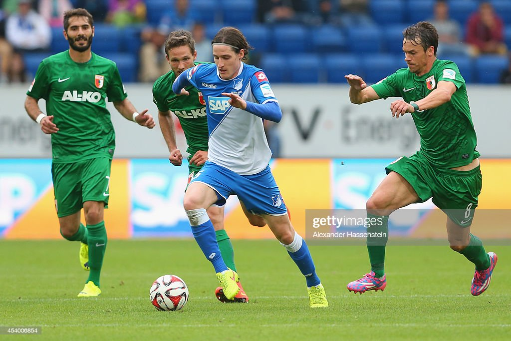 <a gi-track='captionPersonalityLinkClicked' href=/galleries/search?phrase=Sebastian+Rudy&family=editorial&specificpeople=4410074 ng-click='$event.stopPropagation()'>Sebastian Rudy</a> (C) of Hoffenheim battles for the ball with <a gi-track='captionPersonalityLinkClicked' href=/galleries/search?phrase=Markus+Feulner&family=editorial&specificpeople=623655 ng-click='$event.stopPropagation()'>Markus Feulner</a> (R) of Ausgburg and his team mates <a gi-track='captionPersonalityLinkClicked' href=/galleries/search?phrase=Halil+Altintop&family=editorial&specificpeople=602238 ng-click='$event.stopPropagation()'>Halil Altintop</a> (L) and Tim Matavz (2nd L) during the Bundesliga match between TSV 1899 Hoffenheim and FC Augsburg at Wirsol Rhein-Neckar-Arena on August 23, 2014 in Sinsheim, Germany.