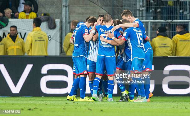 Sebastian Rudy of Hoffenheim celebrates his goal with assistant Eduardo Vargas of Hoffenheim and teammates during the Bundesliga match between 1899...