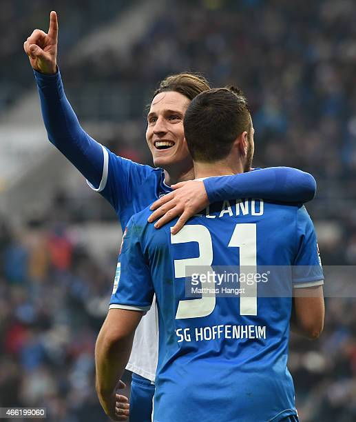 Sebastian Rudy of Hoffenheim celebrates with his teammate Kevin Volland of Hoffenheim after scoring his team's third goal during the Bundesliga match...