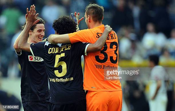 Sebastian Rudy of Hoffenheim celebrates with team mates Marvin Compper and goalkeeper Tom Starke after winning the Bundesliga match between Borussia...