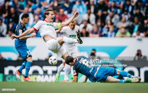 Sebastian Rudy of Hoffenheim challenges Paul Verhaegh of Augsburg during the Bundesliga match between TSG 1899 Hoffenheim and FC Augsburg at Wirsol...