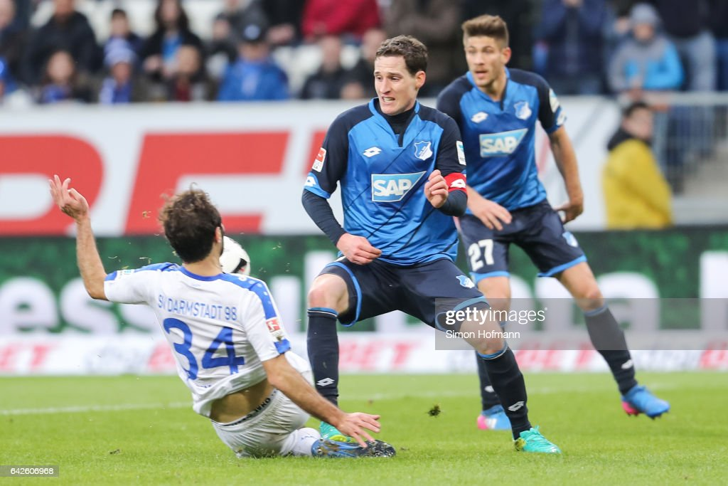 Sebastian Rudy of Hoffenheim is challenged by Hamit Altintop of Darmstadt during the Bundesliga match between TSG 1899 Hoffenheim and SV Darmstadt 98 at Wirsol Rhein-Neckar-Arena on February 18, 2017 in Sinsheim, Germany.