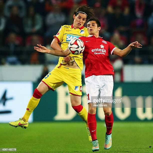 Sebastian Rudy of Hoffenheim is challenged by Jonas Hofmann of Mainz during the Bundesliga match between 1 FSV Mainz 05 and 1899 Hoffenheim at Coface...