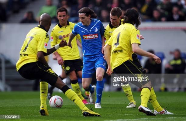 Sebastian Rudy of Hoffenheim is challenged by Lucasz Piszczek of Dortmund during the Bundesliga match between 1899 Hoffenheim and Borussia Dortmund...