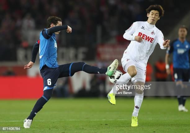 Sebastian Rudy of Hoffenheim is challenged by Yuya Osako of Koel during the Bundesliga match between 1 FC Koeln and TSG 1899 Hoffenheim at...