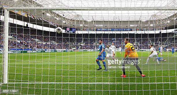 Sebastian Rudy of Hoffenheim scores his team's first goal against goalkeeper Daniel Davari of Braunschweig during the Bundesliga match between 1899...