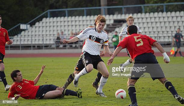 Sebastian Rudy of Spain battles for the ball with Toni Kroos of Germany during the U19 Euro Qualifier match between Spain and Germany at the A Le Coq...