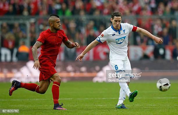 Sebastian Rudy of TSG Hoffenheim is challenged by Arturo Vidal of FC Bayern Muenchen during the Bundesliga match between Bayern Muenchen and TSG 1899...