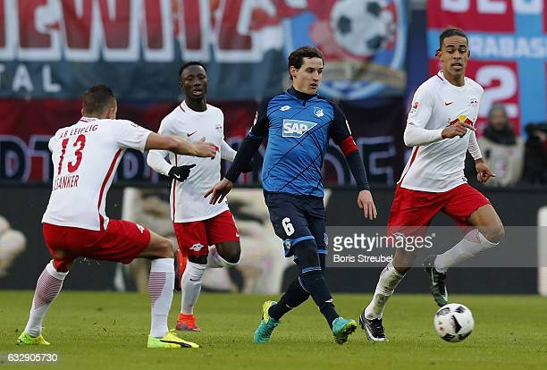 Sebastian Rudy of TSG Hoffenheim is challenged by players of RB Leipzig during the Bundesliga match between RB Leipzig and TSG 1899 Hoffenheim at Red...