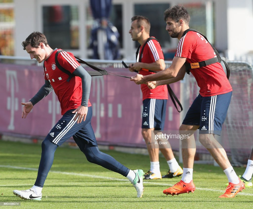 Sebastian Rudy, Rafinha and Javi Martinez (L-R) of FC Bayern Muenchen practice during a training session at the Saebener Strasse training ground on October 12, 2017 in Munich, Germany.