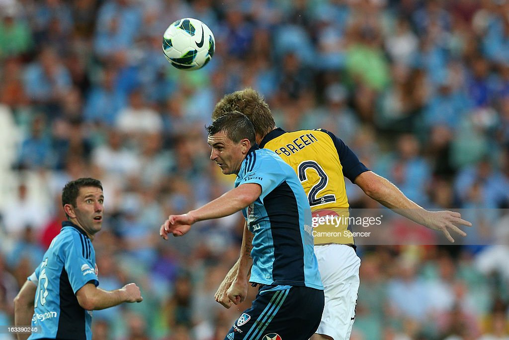 Sebastian Ryall of Sydney FC and <a gi-track='captionPersonalityLinkClicked' href=/galleries/search?phrase=Daniel+McBreen&family=editorial&specificpeople=2229191 ng-click='$event.stopPropagation()'>Daniel McBreen</a> of the Mariners head the ball during the round 24 A-League match between Sydney FC and the Central Coast Mariners at Allianz Stadium on March 9, 2013 in Sydney, Australia.