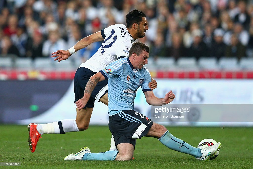 Sebastian Ryall of Sydney FC and Nacer Chadli of Hotspur contest the ball during the international friendly match between Sydney FC and Tottenham Spurs at ANZ Stadium on May 30, 2015 in Sydney, Australia.