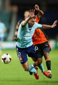 Sebastian Ryall of Sydney tangles with Henrique of the Roar during the round 12 ALeague match between Sydney FC and Brisbane Roar at Allianz Stadium...