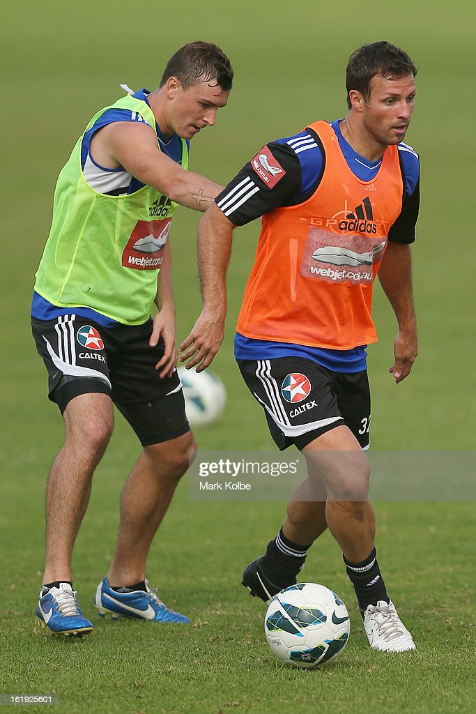 Sebastian Ryall puts pressure on Lucas Neill as he looks to pass during a Sydney FC A-League training session at Macquarie Uni on February 18, 2013 in Sydney, Australia.
