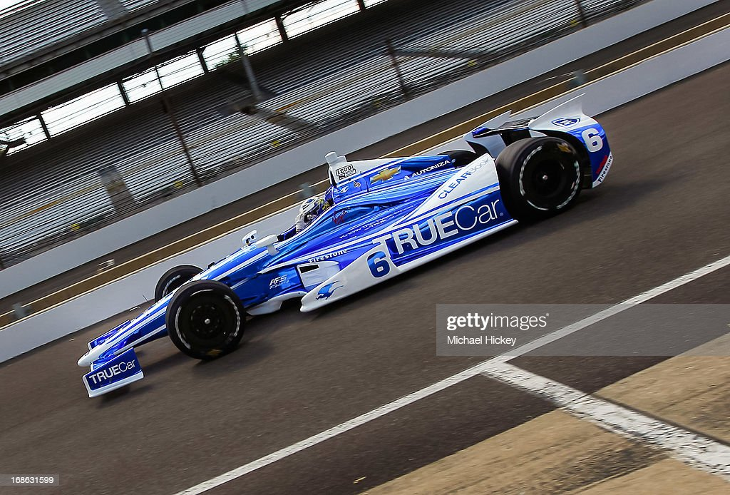 Sebastian Saavedra of Colombia driver of the #6 Dragon Racing Dallara Chevrolet drives down pit lane during Indianapolis 500 practice at the Indianapolis Motor Speedway on May 12, 2013 in Indianapolis, Indiana.