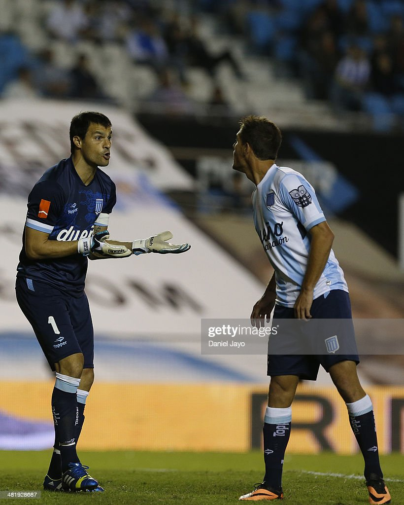 Sebastian Saja (L) and Bruno Zuculini, both of Racing Club, argue during a match between Racing Club and Estudiantes as part of 11th round of Torneo Final 2014 at Presidente Peron Stadium on April 1, 2014 in Buenos Aires, Argentina.